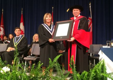 Jane Rufrano, CEO/CFO of Hotel Dieu Shaver Health and Rehabilitation Centre, receives an honorary diploma in Health Studies from NC president Dan Patterson.